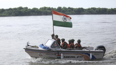 Indian border forces patrol Chenab river along the India-Pakistan border in Akhnoor.