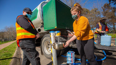 Shanae from Ferntree Gully, collecting clean drinking water from a water tanker.