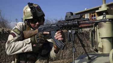 Security personnel take position near the site of an attack near the Bagram Air Base in Afghanistan.