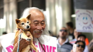 Danny Lim attending a protest over his January 11 arrest with his dog Smarty.