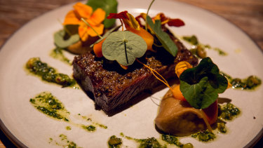 Beef short-rib pastrami, butterscotch horseradish, pistachio pesto at London's Restaurant Scully.
