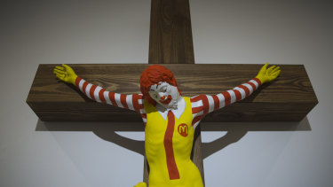 """An artwork called McJesus, which was sculpted by Finnish artist Jani Leinonen and depicts a crucified Ronald McDonald, is seen on display as part of the Haifa museum's """"Sacred Goods"""" exhibit."""