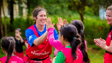 Giving back: Australian sevens star Charlotte Caslick makes some new friends.