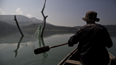 A villager rows a boat at the Doyang reservoir in Wokha district, in the northeastern Indian state of Nagaland.