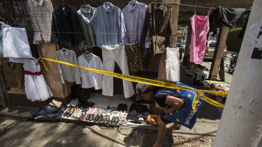 A woman enters a crime scene in Guatemala city. According to the US Homeland Security hunger, not violence, is driving migration from Guatemala to the United States.