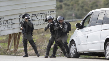 Israeli security forces take position during clashes with Palestinians after a demonstration against the arrest of members of Fatah in Jerusalem by the Israeli authorities, in the West Bank on Sunday.