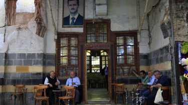 Syrians smoke water pipes at a coffee shop at the Hamidiyeh market, in the Old City of Damascus, Syria, on Sunday.