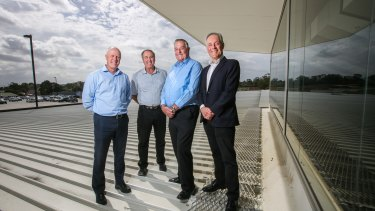 CEP Energy chairman Morris Iemma on the roof of Narellan Town Centre in south-west Sydney with the centre's manager Brad Page, and owners, Arnold Vitocco and Tony Perich.