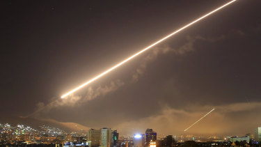 Damascus skies erupt with surface to air missile fire as the US launches an attack on Syria.