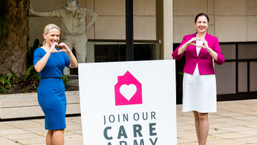 "Innovation Minister Kate Jones and Premier Annastacia Palaszczuk launch the ""care army"" concept yesterday, urging Queenslanders to help neighbours aged over 65."