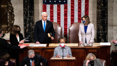US Vice-President Mike Pence and US House Speaker Nancy Pelosi lead the joint sitting of Congress. Joe Biden's election win was finally certified at 3.33am local time.