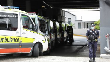 Ambulances at the ready to transport hotel quarantine guests from the Hotel Grand Chancellor in Brisbane on Wednesday.