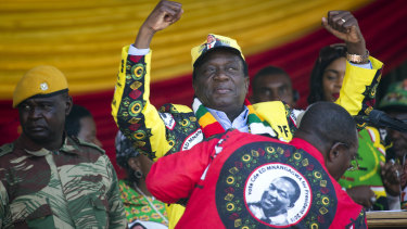 Zimbabwean President Emmerson Mnangagwa addresses the final rally of his campaign at the stadium in Harare, Zimbabwe, on Saturday.