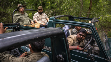 Forest rangers in a tiger reserve in the Indian state of Maharashtra exchange information about tiger sightings.
