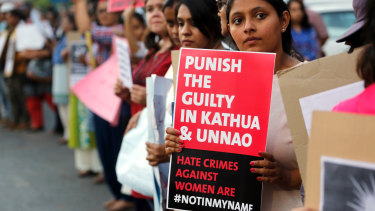 An Indian girl holds a placard during a protest against two recently reported rape cases, on Wednesday.