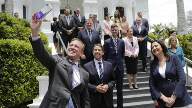 Deputy Premier Steven Miles wrangles his newly sworn-in cabinet colleagues for a selfie at Government House.