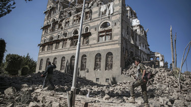 Houthi Shiite rebels inspect the rubble of the Republican Palace that was destroyed by Saudi-led airstrikes, in Sanaa, Yemen, in December last year.