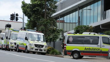 Ambulances ready to transport hotel quarantine guests from the Hotel Grand Chancellor.