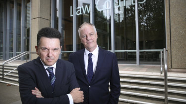 Former senator Nick Xenophon and former ABC foreign correspondent Mark Davis outside the Supreme Court in Sydney.