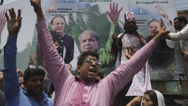 Supporters of former Pakistani prime minister Nawaz Sharif chant slogans on Friday.