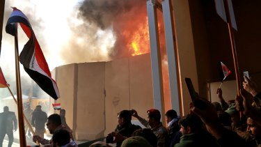 Protesters break into the US embassy compound, in Baghdad, Iraq, on Tuesday.