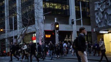 Pedestrians navigate the CBD.
