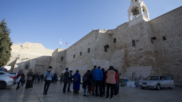 Christian visitors gather outside the Church of the Nativity, traditionally believed by Christians to be the birthplace of Jesus Christ, in the West Bank city of Bethlehem.