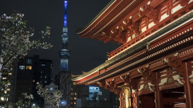The Tokyo Skytree, photographed from Sensoji Temple, is lit in blue to show support for healthcare workers and first responders on the front lines of the coronavirus pandemic