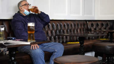 People drink beer in a Liverpool city centre pub ahead of the lockdown closure of bars, gyms and clubs in Liverpool, England.