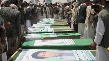 Yemeni people attend the funeral of victims of a Saudi-led airstrike, in Saada, Yemen.