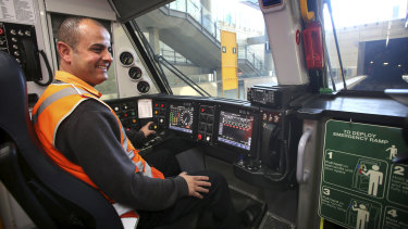 Train driver Adam Ghamrawi at the controls of a new Waratah train at Olympic Park.