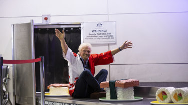 Sir Richard Branson, founder of Virgin Group, arrives on a giant sushi train at the Brisbane-Tokyo announcement.