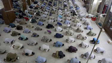 People attend evening prayers while maintaining a level of social distancing to help avoid the spread of the coronavirus, at a mosque in Karachi, Pakistan.