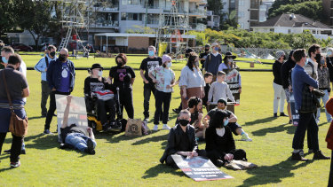 Supporters of Brisbane's Backbone Youth Arts organisation at a rally urging the council to scrap plans to demolish the East Brisbane Bowls Club.