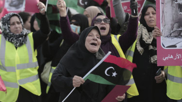 Women take part in a protest against Libya's Field Marshal Khalifa Hifter, who is leading an offensive to take over Tripoli.