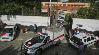 Forensic vehicles transport the bodies of victims of the Raul Brasil State School attack in Suzano, in the greater Sao Paulo, Brazil, on Wednesday.