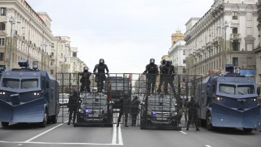 A police barricade with two water cannons is set blocking a street during an opposition rally to protest the official presidential election results in Minsk, Belarus.