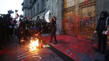 "Protesters covered the entrance to the  National Palace in Mexico City in fake blood and the message: ""Femicide State""."
