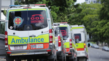 A line of ambulances wait to carry people from the Hotel Grand Chancellor to the site of their extended hotel quarantine stay after concerns about a cluster of the UK COVID-19 strain on the seventh floor.