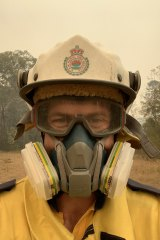 """Firefighter Andrew Hain in the half-face respirator he called a """"game-changer""""."""