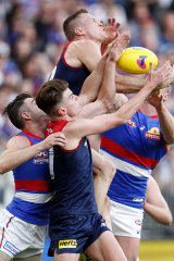 Tom McDonald, Easton Wood, Bayley Fritsch and Alex Keath compete for the ball.