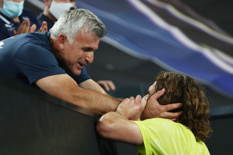 Stefanos Tsitsipas is embraced by his father Apostolos after beating Rafael Nadal.