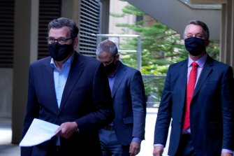 Premier Daniel Andrews, Chief Health Officer Brett Sutton and Health Minister Martin Foley arrive at Treasury Theatre on Tuesday.