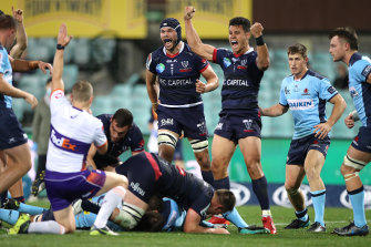 Matt Toomua (third from right) celebrates a try by Rebels teammate Ryan Louwrens on Friday night.