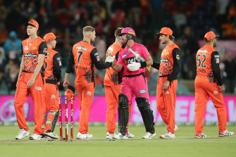 Sydney Sixers star Dan Christian shakes hands with Liam Livingstone of the Scorchers, who are wearing their Indigneous strip.