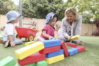Nicola Forrest, co-chair of the Minderoo Foundation, meets with children at a Goodstart Early Learning Centre in Canberra. She is lobbying politicians to overhaul the childcare system to make it universally accessible and affordable.
