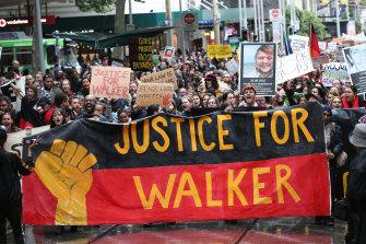Protesters march in Melbourne in November 2019.