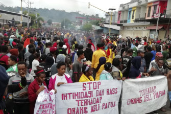 """People display banners that read """"Stop intimidation and racism towards indigenous Papuans"""" during a protest in Manokwari last year."""
