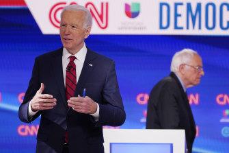 Former vice-president Joe Biden and Bernie Sanders at the debate in Washington.