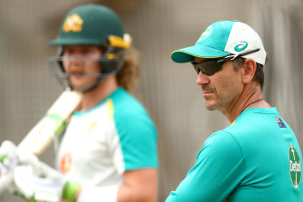Justin Langer watches on as Will Pucovski trains in the nets.